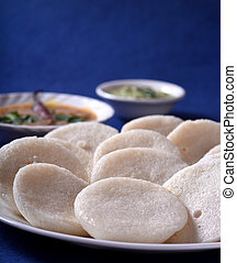 Idli with Sambar and coconut chutney on blue background,...