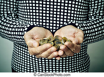 young man with euro coins in his hands - closeup of a young...