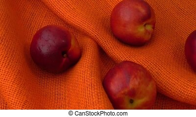 Peach nectarine isolated on orange background