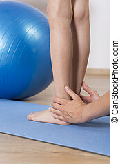 Fixing flat feet - Close up of a physiotherapist correcting...
