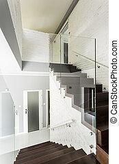White villa staircase idea - White staircase with wooden...