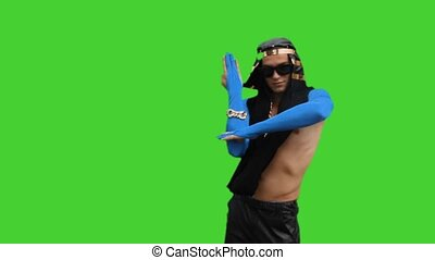 Guy in Egyptian costume is dancing on a green background