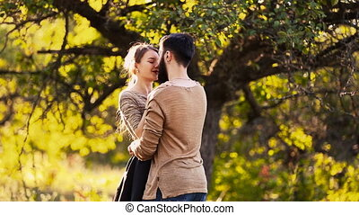Young couple hugging on nature