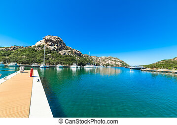 Poltu Quatu harbor under a clear sky, Sardinia