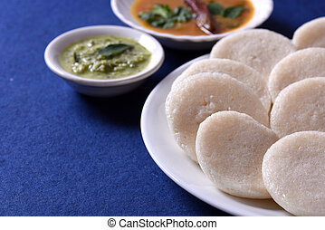 Idli with Sambar and coconut chutney on blue background,...