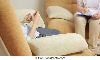 female psychologist with the boy. - Child psychologist with...