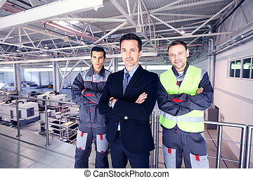 Manager and workers in factory