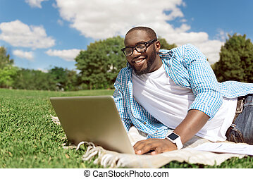 Positive smiling man using laptop - Share emotions Positive...