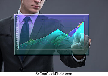 Businessman working with graph in business concept