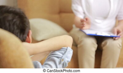 female psychologist with the boy - Child psychologist with a...