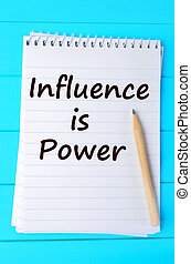The words Influence is power on notebook - The words...