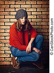 generation - Modern girl teenager sitting relaxed by a brick...