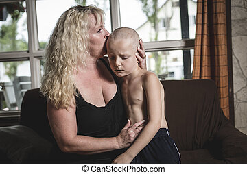 Mother hugs crying living room son - A Mother hugs crying in...