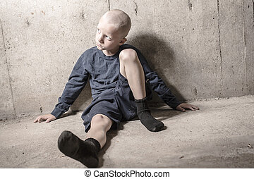 Neglected lonely child leaning at the wall - A Neglected...
