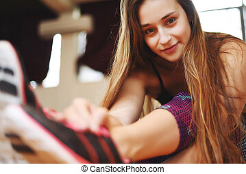 Athlete young woman doing exercise at gym. Indoors. - Close...
