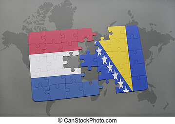 puzzle with the national flag of netherlands and bosnia and...