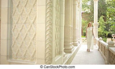 beautiful girl walking on the Arabic palace. tourism...