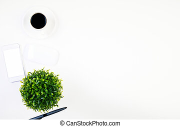 Phone, coffee, pen and plant - Top view of bright office...
