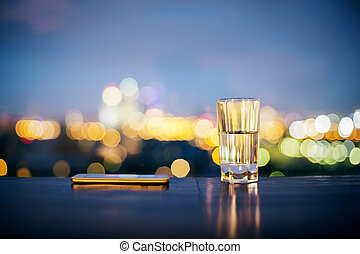 Water glass and smartphone - Closeup of dark surface with...