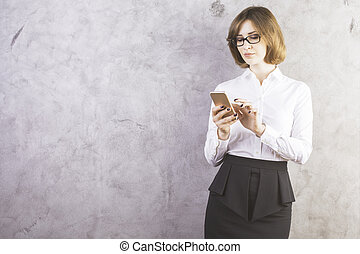 Woman using smartphone - Pretty caucasian woman in formal...