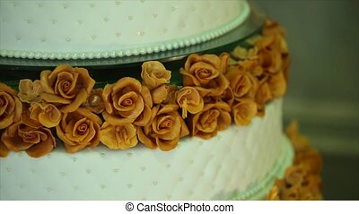 Detail of wedding cake with flowers.