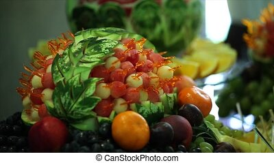 carving food. decorated buffet of fruit