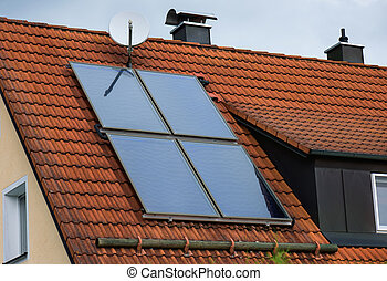 Solar panel on roof - Solar panels on the red house roof...