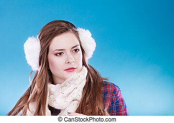Young woman in wintertime - Young woman wearing fluffy white...