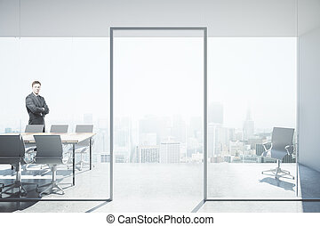 Businessman in conference room - Thoughtful businessman with...