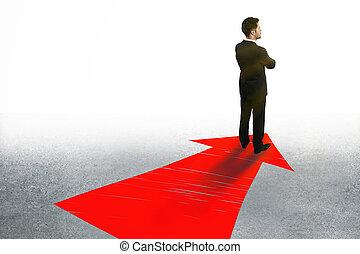 Businessman on arrow