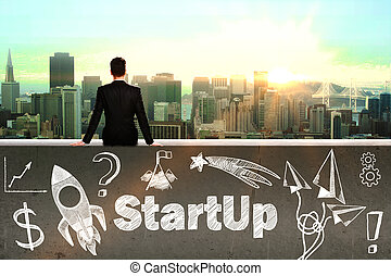 Startup concept with sitting businessman looking at city and...