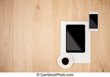 Tablet, smartphone and coffee - Top view of blank tablet,...