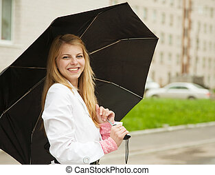 girl with umbrella outdoors - Pretty girl in cloak with...