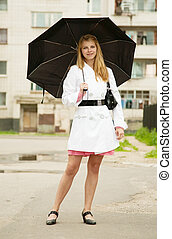 girl   with umbrella outdoors
