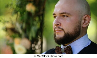 Close up portrait of handsome stylish bald-headed groom...