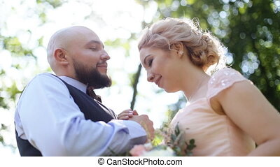 Sensual close up portrait of handsome groom kissing forehead...