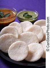 Idli with Sambar and coconut chutney on violet background,...
