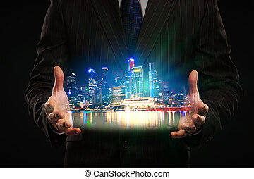 Man holding city hologram