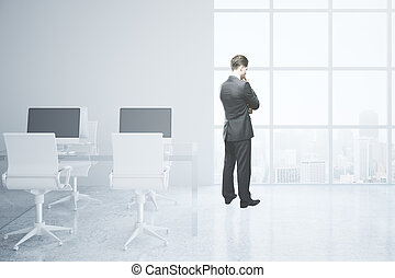 Thoughtful man in office - Thoughtful businessman in bright...