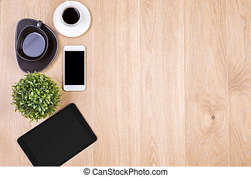 Technology and coffee - Top view of wooden desktop with...