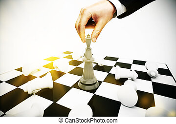 Businessperson playing chess - Businessman playing chess on...