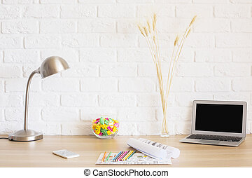 Desktop on brick wall background - Creative desktop with...