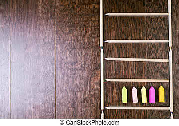 Pencil ladder and sticker arrows - Top view of wooden...