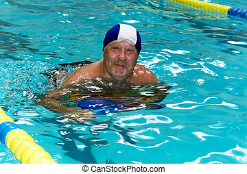 Active happy senior in swimming-pool