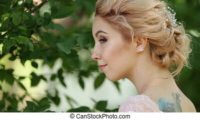 Charming blond woman in her tan dress looking over her...
