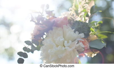 Wedding. The bride's bouquet. Wedding bouquets of white and pink flowers with green illuminated by sunlight