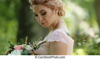Day dreaming bride - blonde in pink dressand with tattoo...