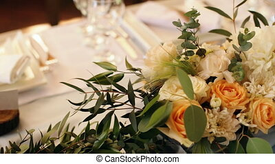 Wedding table decorated with candles, served with cutlery...