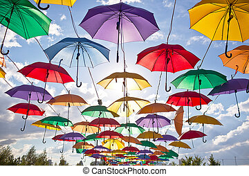 Installation from multicolored umbrellas in the park of the...