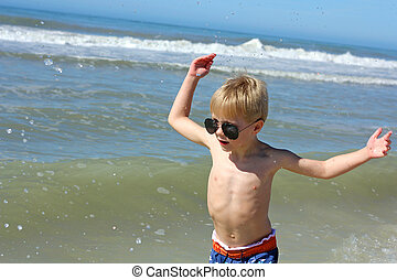 Happy Young Child Playing in the Ocean